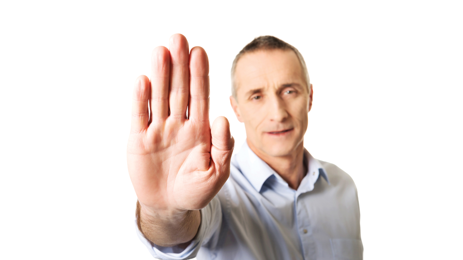 man making a stop gesture with his hand